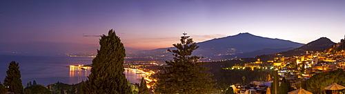 Panoramic view of Mount Etna and Giardini Naxos at dusk from Taormina, Sicily, Italy, Mediterranean, Europe