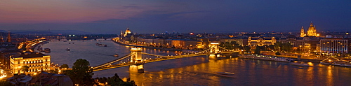 Panorama of the city at dusk with the Hungarian Parliament building and the Chain bridge (Szechenyi Lanchid) over the River Danube, UNESCO World Heritage Site, Budapest, Hungary, Europe