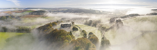 Aerial view by drone of mist over Restormel Castle in Cornwall, England, United Kingdom, Europe