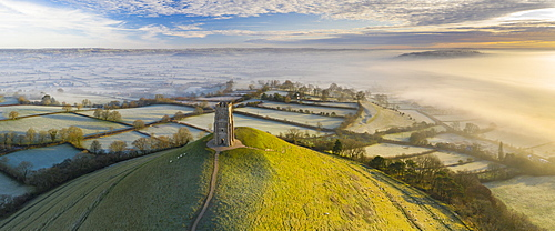 Aerial view by drone of frosty winter morning at Glastonbury Tor, Somerset, England, United Kingdom, Europe