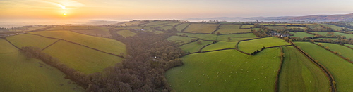 View by drone of early Spring sunrise over the rolling countryside of Devon, England, United Kingdom, Europe