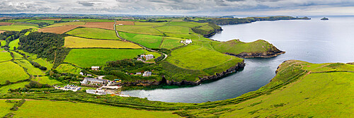 Aerial vista of Port Quin on the North Cornish coast, Cornwall, England. Summer (August) 2020.