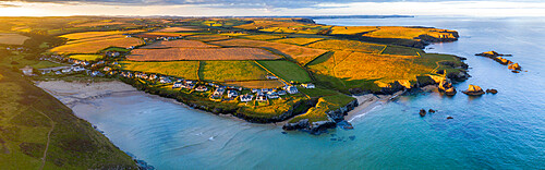 Aerial panorama of Porthcothan Bay and rugged Cornish coastline at dawn, Cornwall, England, United Kingdom, Europe