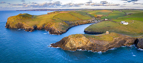 Aerial vista of Doyden Castle on the headland at Port Quin, Cornwall, England. Spring (April) 2021.