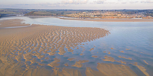 Aerial view of Padstow and the Camel Estuary at low tide, Padstow, Cornwall, England. Spring (May) 2021.
