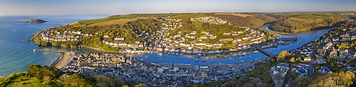 Aerial panoramic view of the beautiful Cornish fishing town of Looe on a sunny spring morning, Looe, Cornwall, England. Spring (April) 2021.