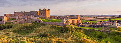 Aerial view by drone of Bamburgh Castle, Bamburgh, Northumberland, England, United Kingdom, Europe