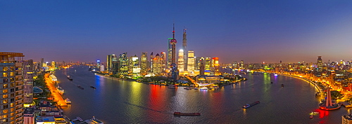 Pudong skyline across Huangpu River, including Oriental Pearl Tower, Shanghai World Financial Center and Shanghai Tower, Shanghai, China, Asia