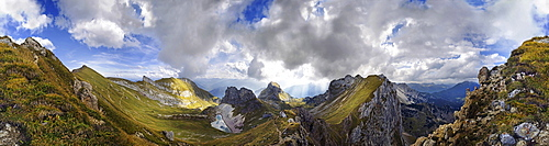 360° view from Seekarlscharte Mountain with Gruba Lake and bizarre clouds in the sky over the Rofan Mountains, Achensee, Tyrol, Austria, Europe
