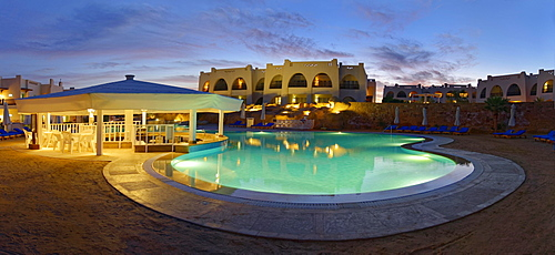 Swimming pool with palm trees at sunset, Hilton Nubian Resort, Al Qusair, Marsa Alam, Egypt, Africa