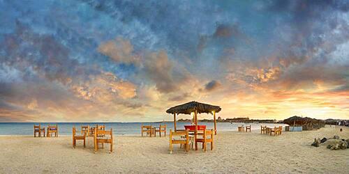 Sandy beach beach with bar at the coral reef Abu-Dabbab at sunset, Hilton Nubian Resort, Al Qusair, Marsa Alam, Egypt, Africa