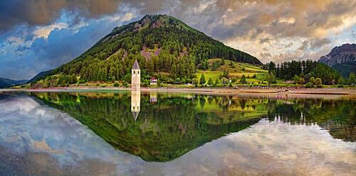 Church tower in the Reschensee with reflection, Graun, Reschen, Trentino-Alto Adige, Italy, Europe