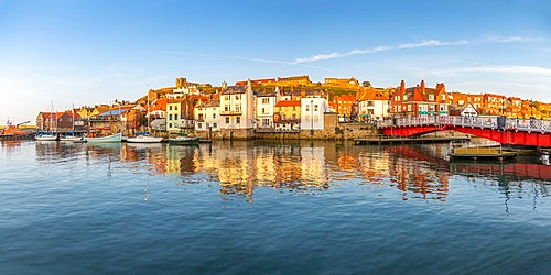 View of St. Mary's Church and reflections on River Esk at sunset, Whitby, Yorkshire, England, United Kingdom, Europe