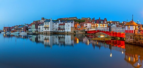 View of Whitby Bridge and reflections on River Esk at dusk, Whitby, Yorkshire, England, United Kingdom, Europe