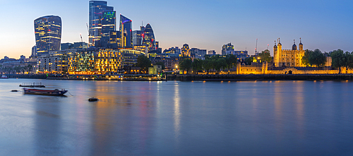 View of the Tower of London, river Thames and City of London at dusk, London, England, United Kingdom, Europe
