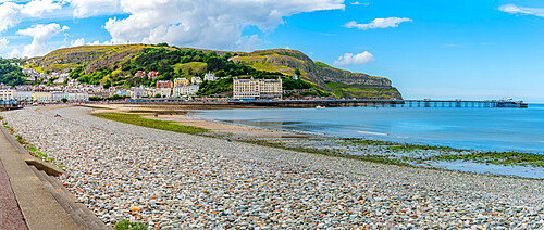 View of Llandudno Pier and the Great Orme in background from promenade, Llandudno, Conwy County, North Wales, United Kingdom, Europe
