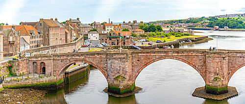 View of the Old Bridge over River Tweed and town houses, Berwick-upon-Tweed, Northumberland, England, United Kingdom, Europe