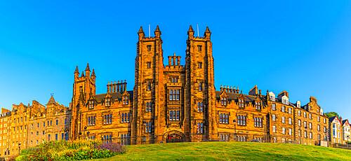 View of New College, The University of Edinburgh, on The Mound, from Princes Street at sunset, Edinburgh, Scotland, United Kingdom, Europe