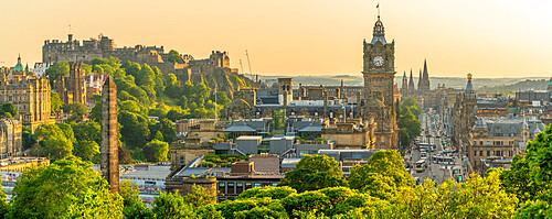 View of Edinburgh Castle, Balmoral Hotel and Princess Street from Calton Hill at golden hour, Edinburgh, Scotland, United Kingdom, Europe