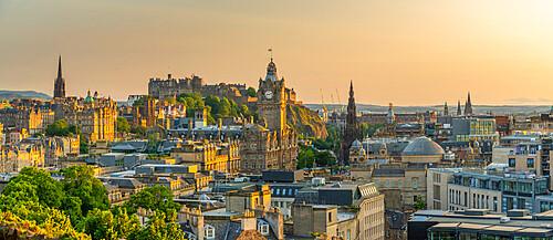 View of Edinburgh Castle, Balmoral Hotel and city skyline from Calton Hill at golden hour, Edinburgh, Scotland, United Kingdom, Europe