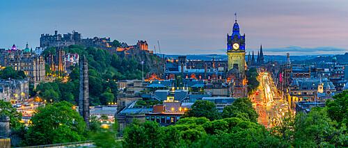 View of Edinburgh Castle, Balmoral Hotel and Princess Street from Calton Hill at dusk, Edinburgh, Scotland, United Kingdom, Europe