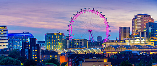 View of the London Eye and rooftop of Waterloo Station at dusk, Waterloo, London, England, United Kingdom, Europe