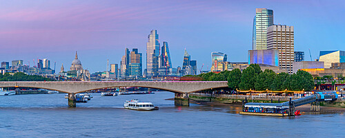 View of Waterloo Bridge, St Paul's Cathedral and The City skyline at dusk, London, England, United Kingdom, Europe