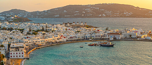 View of town from elevated view point at sunset, Mykonos Town, Mykonos, Cyclades Islands, Greek Islands, Aegean Sea, Greece, Europe