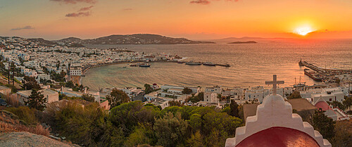 View of chapel and town from elevated view point at sunset, Mykonos Town, Mykonos, Cyclades Islands, Greek Islands, Aegean Sea, Greece, Europe