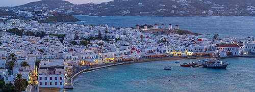 View of windmills and town from elevated view point at dusk, Mykonos Town, Mykonos, Cyclades Islands, Greek Islands, Aegean Sea, Greece, Europe
