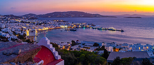 View of chapel and town from elevated view point at dusk, Mykonos Town, Mykonos, Cyclades Islands, Greek Islands, Aegean Sea, Greece, Europe