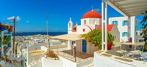 View of narrow street and red domed chapel overlooking Aegean Sea, Mykonos Town, Mykonos, Cyclades Islands, Greek Islands, Aegean Sea, Greece, Europe