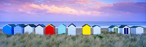 Colourful beach huts and sand dunes at sunset, Southwold, Suffolk, England, United Kingdom, Europe