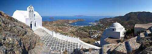 View of Livadi Bay and white Greek Orthodox churches from atop Pano Chora, Serifos, Cyclades, Aegean Sea, Greek Islands, Greece, Europe