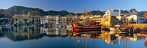 The boat filled harbour and mountains with mirror reflection, Kyrenia (Girne), Northern Cyprus, Cyprus