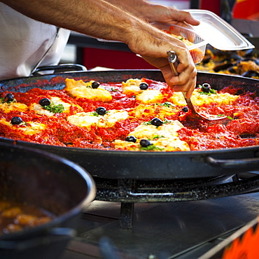 Man cooks Catalan cuisine in the Saturday market, Ceret, France, Europe