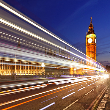 Motion blurred red double decker bus, Houses of Parliament, Big Ben, Westminster Bridge, London, England, United Kingdom, Europe