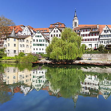 Old town with Hoelderlinturm tower and Stiftskirche Church reflecting in the Neckar River, Tuebingen, Baden-Wurttemberg, Germany, Europe