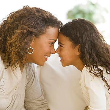African mother and daughter touching noses