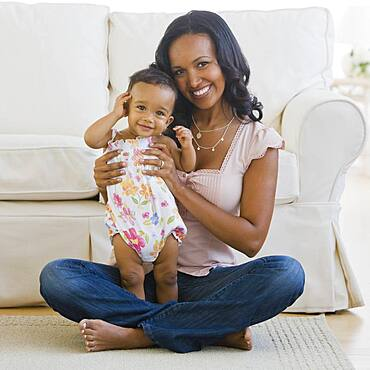African American mother and baby on floor