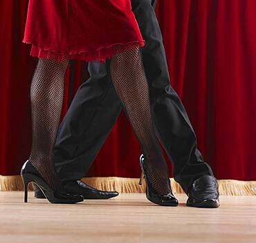 Close up of dancing couple's legs