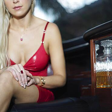 Close up of woman in sexy dress in limousine