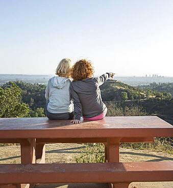 Caucasian women admiring scenic view from hilltop