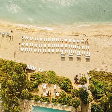Aerial view of hotel pool and tropical beach