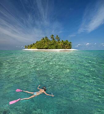 Caucasian woman snorkeling off tropical island
