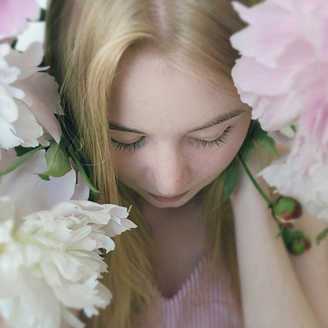 Close up of Caucasian teenage girl holding flowers