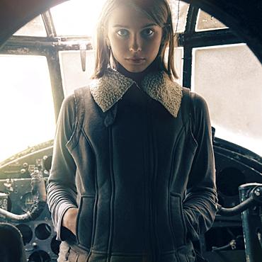 Caucasian woman standing in cockpit