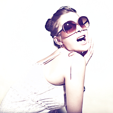 Portrait of glamorous woman wearing sunglasses