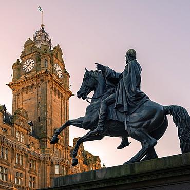 Duke of Wellington monument with the Balmoral clock behind, Edinburgh, Scotland, United Kingdom, Europe