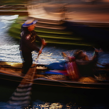 Blurred image of gondolier in Venice, Italy, Europe